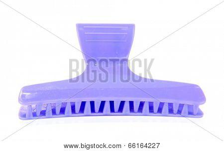 Violet hair-slide isolated on white