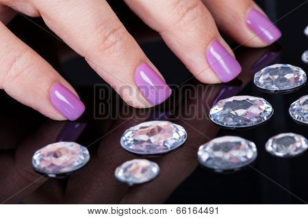 Close-up Of Fingernails And Diamonds