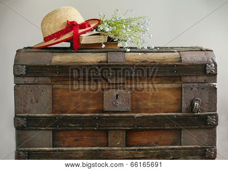 Summer Blue Flowers, Old Books And Straw Hat On Old Vintage Chest
