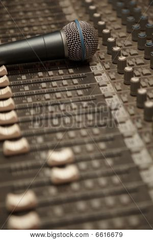 microphone on old dirty sound mixer pult. microphone in focus