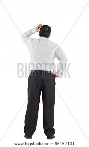 Mature businessman standing scratching head on white background