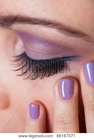 Close-up Of Woman's Eye With Purple Eyeshadow