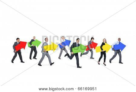 Group of Business People Holding Arrow Signs while Moving Forward