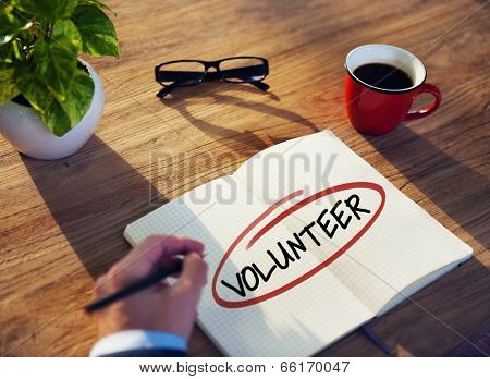 Man with Note Pad and Volunteer Concept