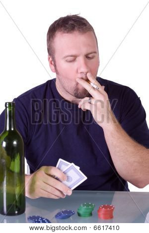 Man With An Empty Whiskey Bottle On A Poker Table