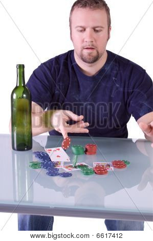 Man Throwing Cards On The Table In Texas Hold'em