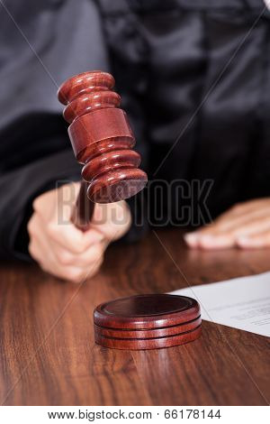 Judge Striking The Gavel In A Courtroom