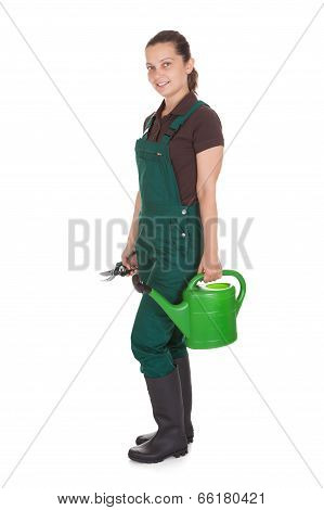 Happy Woman Holding Gardening Tools