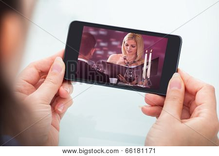 Person Watching Video On Cellphone