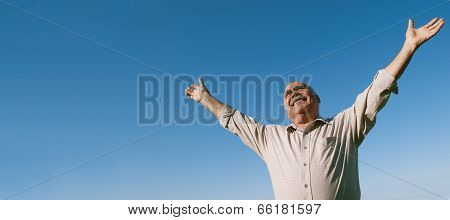 Joyful Senior Man Rejoicing In The Sunshine