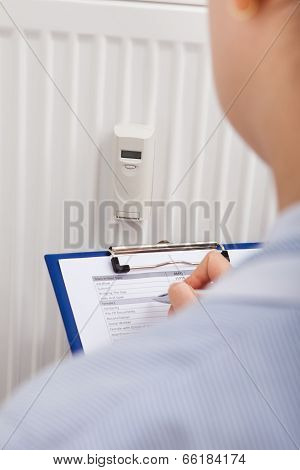 Maintaining Records Of Digital Thermostat On Clipboard