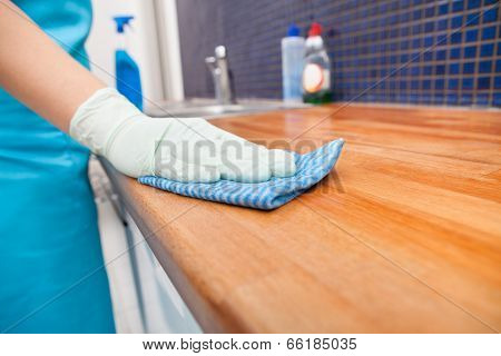 Woman Cleaning Kitchen Countertop