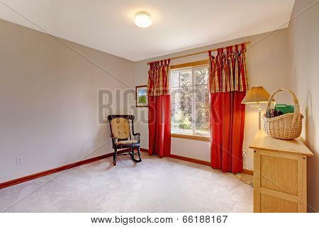 Empty Room Decorated With Rocking Chair