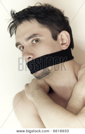 Scared Young Man With Bandage On Mouth Close Up
