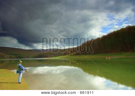 Fisherman Catching Fish On A Lake