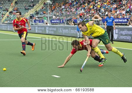 THE HAGUE, NETHERLANDS - JUNE 2: Liam de Young (AUS) and Marc Salles (ESP) struggle to reach the ball first at the World Cup Hockey 2014. Australia beats Spain 3-0
