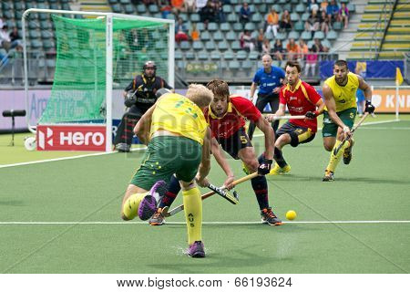 THE HAGUE, NETHERLANDS - JUNE 2: Bosco Perez-Pla (ESP) fails to block Australian attacker Deavin, passing to Ciriello during the World Cup Hockey match between Australia and Spain (3-0)
