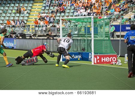 THE HAGUE, NETHERLANDS - JUNE 1: German player Wesley scores the 4-0 during the Hockey World Cup 2014 in the match between Germany and South Africa. GER beats RSA 4-0