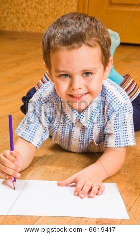 The boy draws pencils