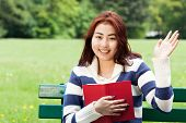 image of mongolian  - Mongolian girl with a book in the park - JPG