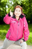 image of mongolian  - Mongolian woman listening to music and training - JPG