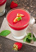 stock photo of panna  - Dessert Panna Cotta with fresh strawberry on old wooden background - JPG