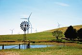 pic of windmills  - Contrast of traditional windmill and wind turbines on an Australian farm - JPG