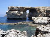 stock photo of gozo  - natural stone arch Azure Window and Mediterranean coastline on Gozo Island - JPG