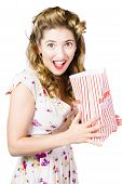 image of unnerving  - Funny shock horror pinup girl holding bag of popcorn bag when watching scary movies on white background - JPG