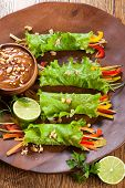stock photo of dipping  - Lettuce wraps with  peanut dipping sauce - JPG