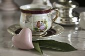 pic of pompous  - tea cup on the table ceramic heart - JPG