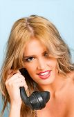pic of bakelite  - sexy woman smiling while using a vintage telephone - JPG
