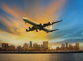 stock photo of air transport  - passenger plane flying above urban scene use for convenience air transport and logistic cargo by air transportation - JPG