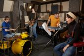image of recording studio  - a rock band is working in studio - JPG