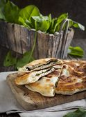 stock photo of sorrel  - Homemade Flatbread With Sorrel and fresh sorrel on table - JPG