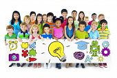foto of pre-adolescent child  - Group of Children Holding Education Concept Billboard - JPG