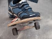 image of skate board  - boy moves up on a skate board - JPG