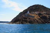 stock photo of emplacements  - View from Ocean level of Canadian National Historical Site Fort Amherst and ruins of built in WWII bunkers - JPG
