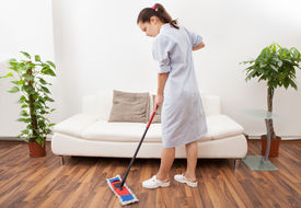 image of maids  - Portrait Of A Young Maid In Uniform Cleaning Floor With Mop - JPG
