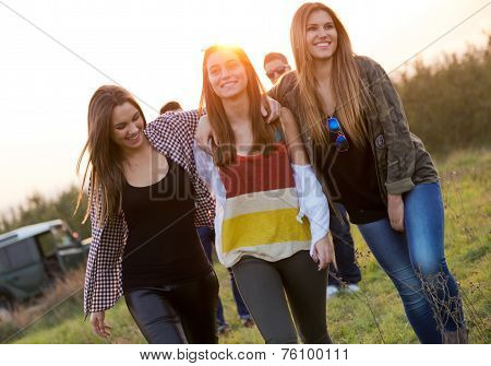 Portrait Of Group Of Friends Having Fun In Field.
