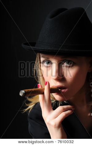 Beautiful Girl In A Hat Smoking A Cigar