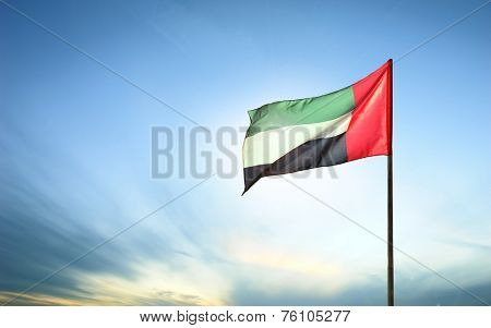 A United Arab Emirates flag flying against clean and tranquil sky. UAE celebrates it's national day on 2nd December every year.