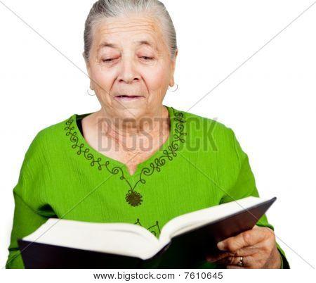 Amazed Senior Woman Reading Surprise Book