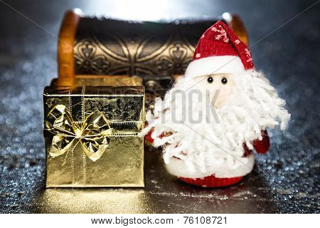 Santa Claus Or Father Frost With Gift Box Or Present And Chest