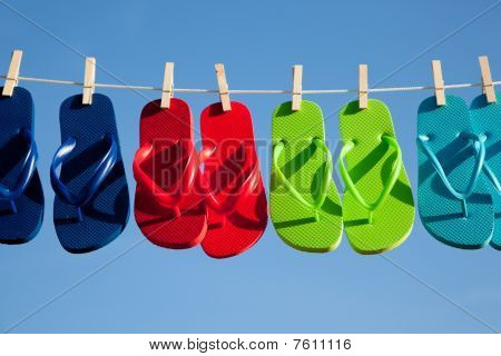 Row Of Flipflops Against A Blue Sky