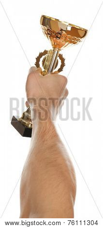 Gold cup in hand isolated on white