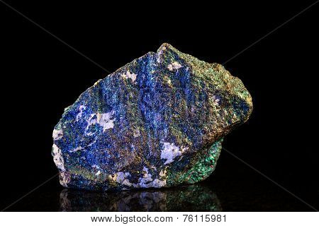 Chalcopyrite Mineral Stone In Front Of Black