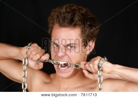 Young Man Biting A Chain