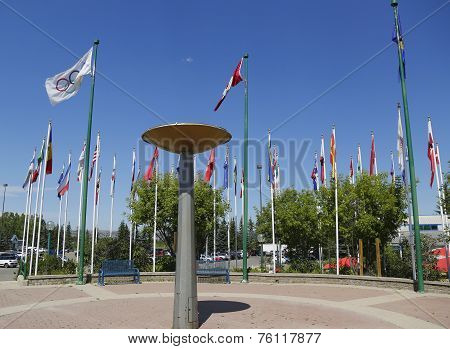 Cauldron and international flags in Canada Park in Calgary