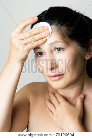 Asian woman clean face